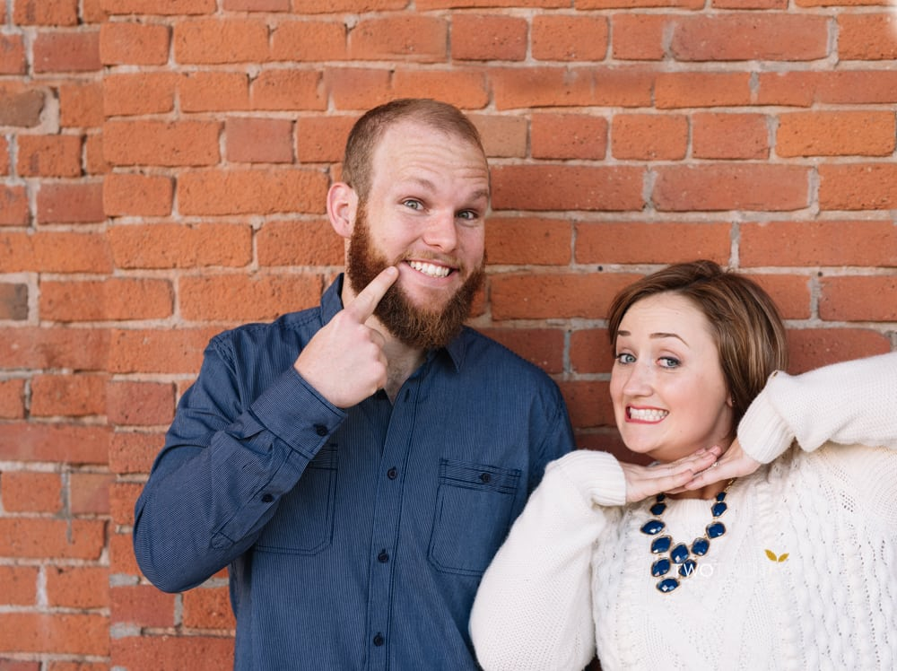 Anniversary portrait photos in old sacramento red brick wall silly faces-2