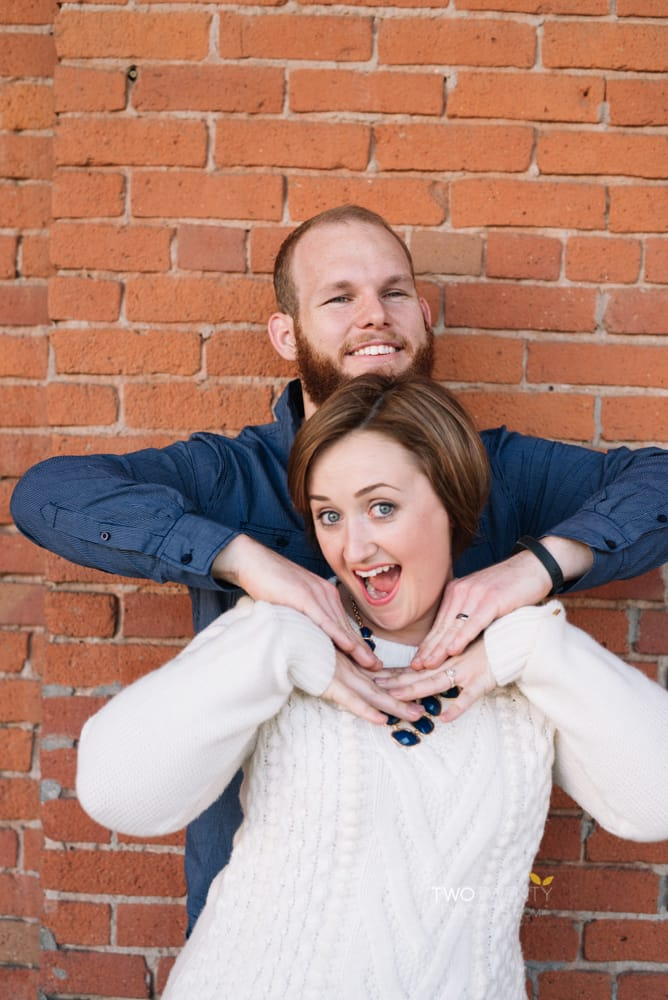 Anniversary portrait photos in old sacramento red brick wall silly faces-3