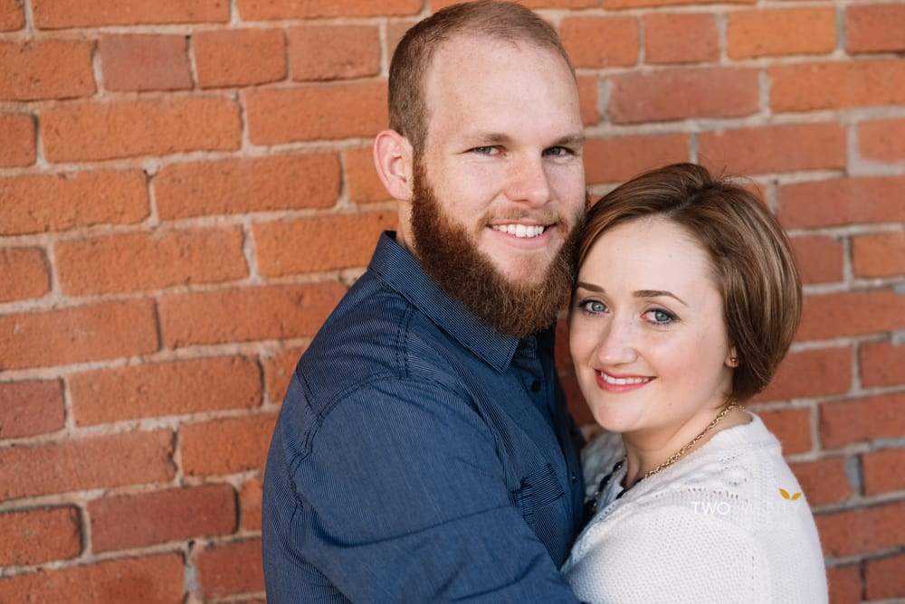 Anniversary portrait photos in old sacramento red brick wall silly faces-6