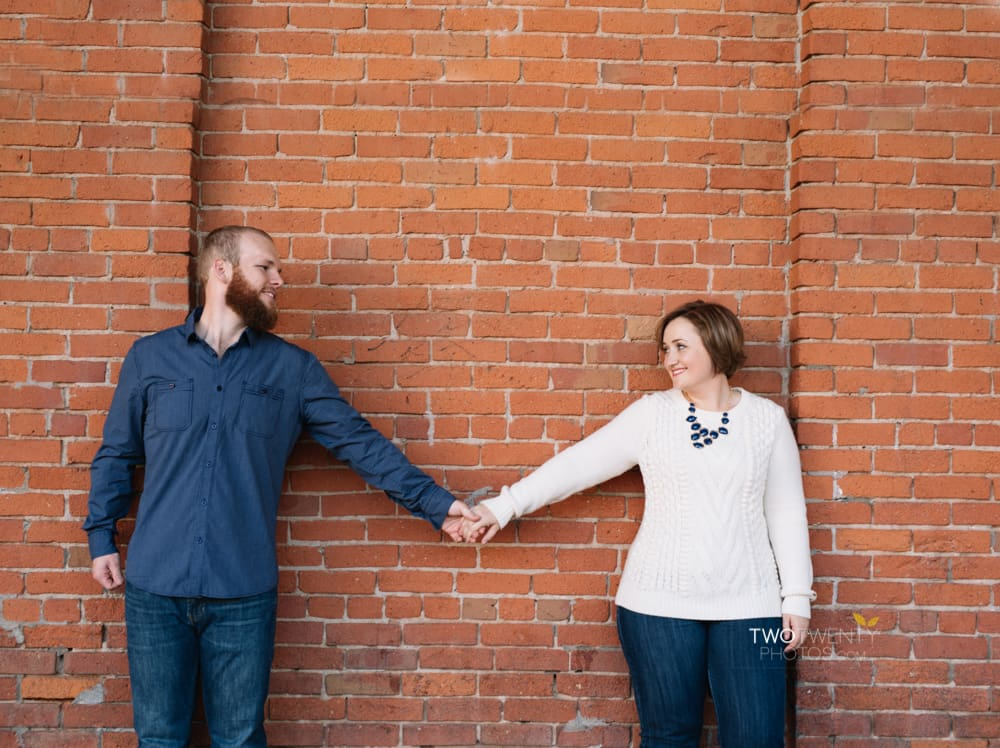 Anniversary portrait photos in old sacramento red brick wall silly faces-8