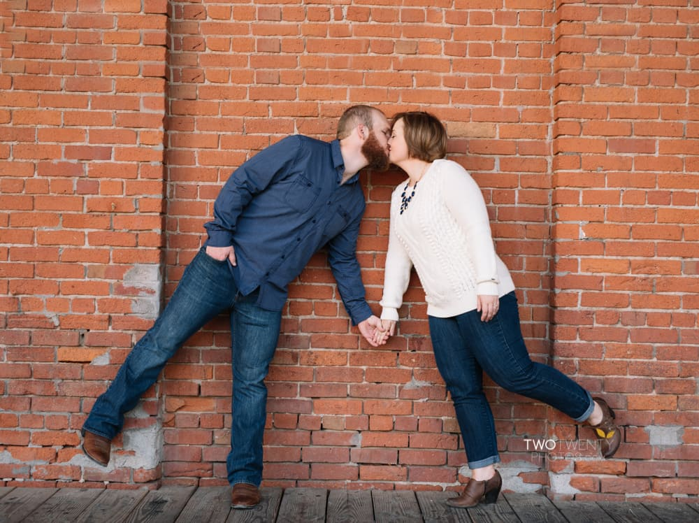 Anniversary portrait photos in old sacramento red brick wall silly faces-9
